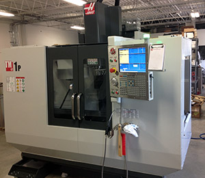 image of CNC machine center for cutting of test speciemns for physical testing